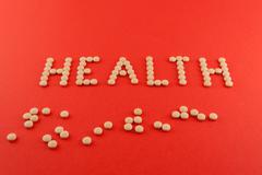 Health word pills supplement sport Stock Photos