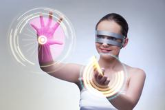 Techno girl pressing virtual buttons Stock Photos