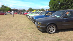 Vintage collector's car in line, cars exhibition in France - summer - pan Stock Footage