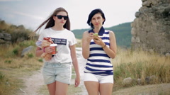 Portrait of two beautiful female friends with coffee and smartphone in the old Stock Footage
