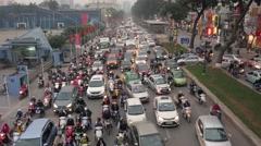 4K Rush hour in Vietnam, crowded traffic at intersection. High angle, long shot. Stock Footage