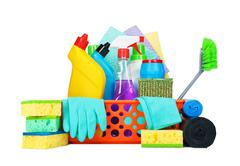 Variety of cleaning supplies in a basket - stock photo