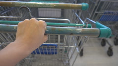 Woman hand taking shopping cat at supermarket Stock Footage