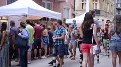 People crowd walking along an urban cultural festival street in Sofia Bulgaria Stock Footage