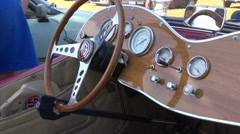 Inside an English vintage car - Dashboard of MG car in an collector exhibition Stock Footage