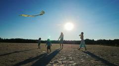 Happy family fun - runs into the sky kite Stock Footage