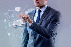 Young businessman in cloud computing concept Kuvituskuvat