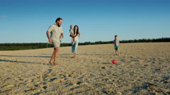 Young family playing football with two little boys - stock footage