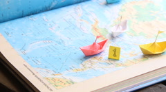 Winner in sports or in business leadership idea, paper boats on the map Stock Footage