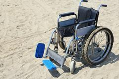 Robust wheelchair made of aluminum with special tires Stock Photos