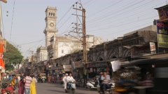 Street with traffic and clock tower,Jamnagar,India Stock Footage