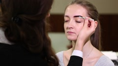 Beautician Colors the Eyebrows With Henna Stock Footage