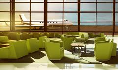 Green sofa on the luxury airport lobby Stock Photos