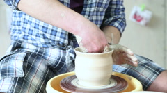 The potter makes clay vessel Stock Footage