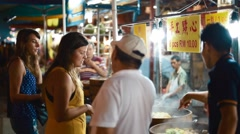 People wait as their food is made on jalan alor food street Stock Footage