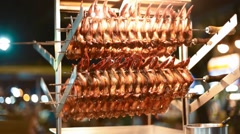 Meat cooling after being cooking over open flame on jalan alor food street Stock Footage