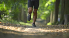 Sportsman run in the beatiful forest. Real time capture. Super telephoto lens Stock Footage
