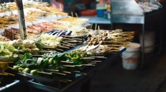 Food prepared on jalan alor food street - stock footage