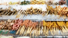 Skewers ready to eat on jalan alor food street - stock footage