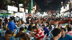 People enjoy food on jalan alor food street - stock footage