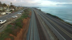 A beautiful aerial above the railroad track along the California coastline north Stock Footage
