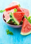 Triangular slices of fresh watermelon on blue wooden background Stock Photos