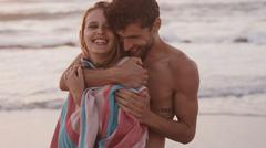 Affectionate young couple hugging on beach Stock Photos