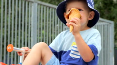 Little boy eating ice-cream and smiling Stock Footage