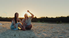 Young family having fun with kids - blow bubbles at sunset Stock Footage