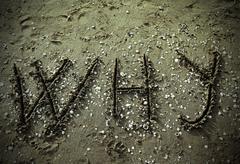 Why big written on the beach Stock Photos