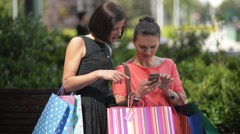 Relax after a successful shopping experience, Young girl with colorful shopping Stock Footage