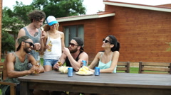 Teenagers having drinks at the picnic area Stock Footage