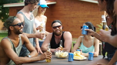 People having drinks at the picnic area Stock Footage