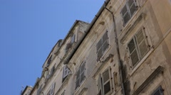 4K Tilt down residential building with traditional facade in Corfu old town shop Stock Footage