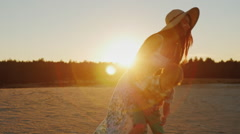 Young mother with long hair playing with his son at sunset. Fun turns it around Stock Footage