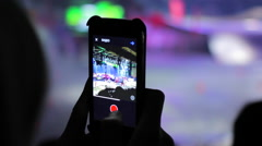 Young woman recording concert show with her phone Stock Footage