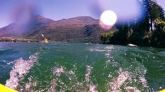 Kayak Adventure. Water Splash on Camera. Lake with Mountains Stock Footage