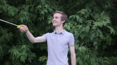 Young man making selfie in park Stock Footage