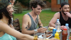 Teens eating and drinking at the picnic area Stock Footage