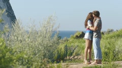 Young couple at sunny weather embracing near romantic lighthouse. Back view Stock Footage