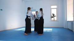 Three girls in black hakama practice Aikido Stock Footage