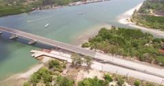 Ship sailing under the bridgeSiriLanta bridge Stock Footage