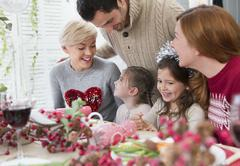 Smiling family at Christmas dinner Stock Photos