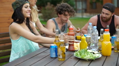 Teens eating at the picnic area Stock Footage