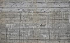 Concrete wall with cement sags and runs Stock Photos