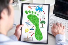Carbon footprint concept on a clipboard Stock Photos