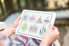 Brand concept on a tablet - stock photo