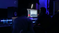 Sound designer recording a song on a professional sound studio Stock Footage
