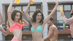 Friends dancing and having fun at the pool Stock Footage
