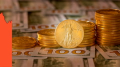 4K US Mint pure gold coins with graph showing falling gold price Stock Footage
